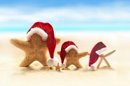 Starfish on summer beach and Santa hat. Merry Christmas.