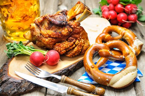 Roasted pork knuckle with pretzels and beer. Oktoberfest